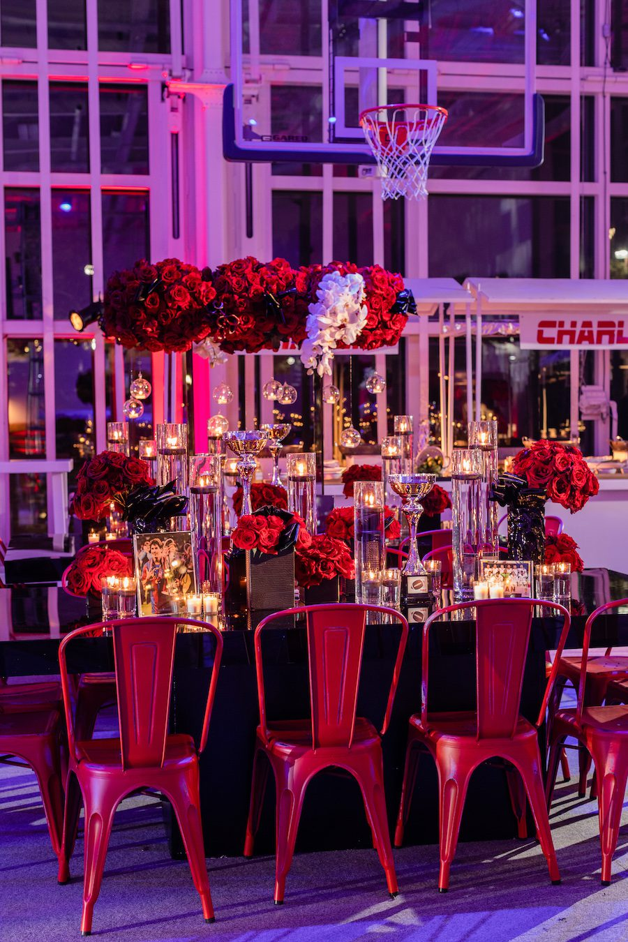 tabletop decor with large red bouquets at celebration party